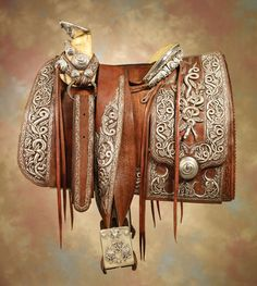 World Record For Pancho Villa Saddle.  The saddle, made and marked by expert craftsmen, is smothered in silver-wrapped threads and boldly-domed silver conchos. It is adorned with exquisitely crafted 3-dimensional silver snake head.