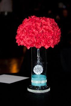 Red silk rose ball centerpieces.