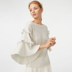 """Cashmere opens up. Wide bell sleeves with ruffled details make the classic fabric feel new and as luxurious as ever. Cashmere Relaxed fit 23½"""" in length, based on a size M Round, wide neck; rib knit trim at neck and hem; wide bell sleeves; ruffle details at the sleeves Dry clean Imported"""