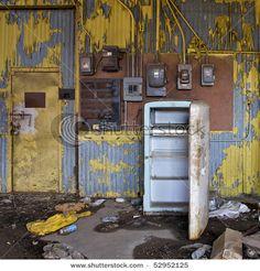 Abandoned warehouse with peeling yellow paint on the walls. Atlanta, Georgia, USA.
