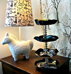 Repurpose vinyl records into a jewelry stand...with metal bobbins on the center rod that you can hang earrings from!