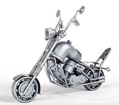 Chopper Motor - MetalDiorama Metal Art Scupture. Chopper Motor - MetalDiorama Metal Art Scupture My products are crafted with care. Quality is the most important thing, so i wanted to create these collectibles as detailed as i could. Fits good into any collection. UNIQUE HANDMADE METAL SCULPTURES MADE FROM NUTS AND BOLTS by cutting, bending and welding steel, utilizing metal and heat to create free-standing sculptures. Some of this metal comes from recycled scrap metal, junk yards, cars...