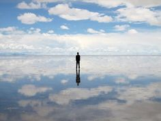 Slat flat in Bolivia. During the raining season, the water turns into the world's largest mirror. The reflection makes it look as though you are standing in the clouds.