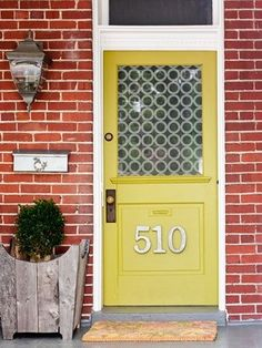 Happy yellow door with large numbers - lovin' this door - what color door goes with a mint green house?  maybe just white?  love the house numbers too... would love to do something more unique like this...