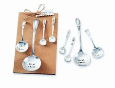 "- Vintage style ladle serving spoons set with engraved messages - Large size ladles are stamped ""Get saucy"" and ""Oh my gravy"" and small spoons read ""Just a dollop"" - Servers are approximately 3-1/2"" t"
