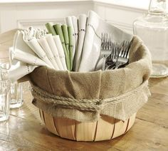 Make setting the table easy with a burlap lined basket for napkins & utensils. Instead of rope i will use a satin ribbon. Great for outdoor get togethers/ cookouts.