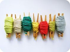 clothespins & toilet paper rolls to store yarn scraps