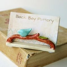 Little bird on a white picket fence ceramic business card holder bird on a twig business card holder french cream reheart Images