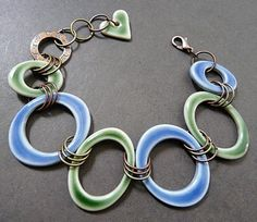 Porcelain jewelry components on an artisan necklace from The Rabbit Muse blog. Created by artist Nancy E. Schindler.
