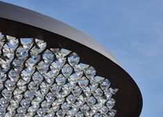 This umbrella-shaped street lamp by London designer Samuel Wilkinson has a crystal-covered canopy.