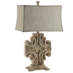 Add elegant appeal to your living room or den with this eye-catching crystal table lamp, featuring a cinched rectangular shade and scrolling base.