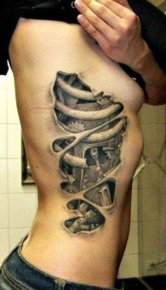 rib side tattoo for fashion girls.Awesome Tattoos and Tattoo Designs   #tattoo #design #girls www.loveitsomuch.com
