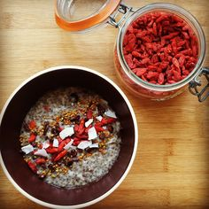 After running out a couple of weeks ago, a big bag of organic goji berries arrived in the post yesterday - yay! I went a bit crazy with them in this morning's porridge,  which is a mix of #glutenfree oats and #chia. I also grated a little bit of creamed coconut in and added coconut flakes, as I was in a kinda coconut mood.  #porridgediaries #porridge #goji #breakfast #healthy #vegan #vegetarian #hbloggers