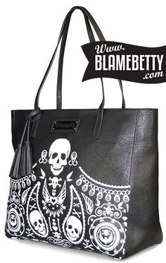 """Tote your essentials in the rad Skull Bandana Embossed Tote! This rockabilly-inspired bag will fit anything and everything you need, including a 13"""" laptop. #blamebetty #skull #rockabilly"""