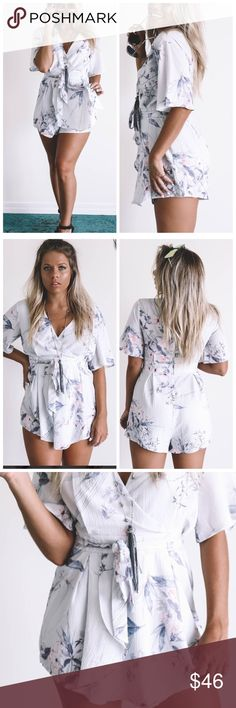 Grey Tone Floral Romper Grey romper features a floral print, short sleeves, a v-neckline, a tie belt waist, and lining Material is Polyester and Rayon Zipper Back Model Bailey is 5'2 wearing a small           Bust	Length	Inseam Small	17	27	2 Medium	18	28	3  Large	19	29	4 Tops Crop Tops