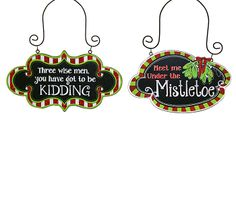 """#burtonandburton Wooden signs with assorted messages, glitter accents, and wire hangers. Red/white striped sign message: Three wise men, you have got to be KIDDING. Red/green striped sign with mistletoe and message: Meet me Under the Mistletoe.Three Wise Men: 4""""H X 8""""W and 7""""H overall.Mistletoe: 4 1/4""""H X 7""""W and 6""""H overall.2 assortments of 2."""