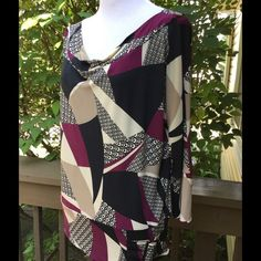 SALE ! Ideology Beautiful Top.   Gorgeous cowl neckline 3/4 length sleeves!!! Cool silver buckle sewn into bottom left side, says Ideology!!! Geometric pattern with beautiful colors!! Light and medium shades of tan, black, and maroon!! Wear any season! Doesn't wrinkle! 94% polyester, 6% spandex. Like new!! Worn twice! Says hand wash cold, line dry. I did put on delicate cycle on low spin hung to dry and it was fine. Up to you though. Very flattering!! Ideology Tops