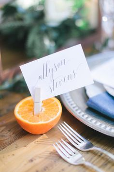citrus place setting - photo by Andrew Jade Photography http://ruffledblog.com/scottsdale-wedding-inspiration-with-citrus