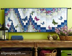 """February is the perfect time for a breath of fresh air, for a hint of spring. Which makes it the perfect time for Ann Lauer's wall quilt, """"All Aflutter,"""" featured in the April 2016 issue of American Patchwork & Quilting. Ann designed this quilt using a bargello quilt-as-you-go technique and her Butterfly Forest fabric collection. 