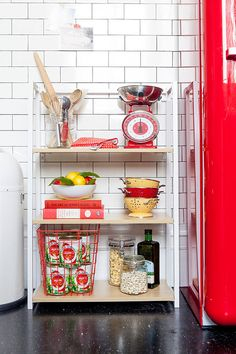 You'd be surprised at how many different ways you can arrange a compact bookcase. Here, it acts as the perfect kitchen storage unit, but it also works in the bedroom and kids' room.