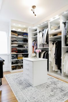 Crisp, clean, modern, white walk in closet // dream closet design by @caclosets // organize // black and white // eatsleepwear // interiors // home