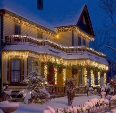 A beautiful house at Christmas time. I want this to be my house please...