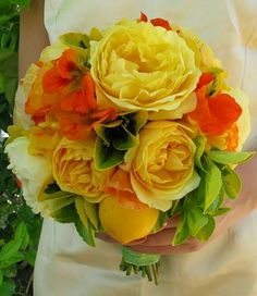 I love this mix of yellow garden roses with crisp greens and a touch of orange