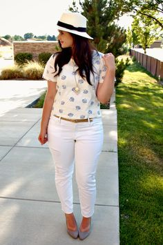 panama hat, printed shirt, white jeans