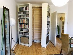 two Billy bookcases open up to reveal a DIY Murphy bed. Get all the details from IKEA Hackers. from Little Life Savers: Clever IKEA Hacks for Small Spaces Ikea Hack, Murphy-bett Ikea, Kallax Hack, Ikea Kallax, Cama Murphy, Ikea Billy Bookcase Hack, Billy Bookcases, Murphy Bed Bookcase, Bookshelves Ikea