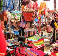 "(#ridecolorfully Peru). Repinned by Elizabeth VanBuskirk. The tourist section of a Peruvian market, probably Pisac. Which are ""trade goods,"" things people have made to sell? Which are fine old weavings merchants have acquired from Inca village people, often at too-low amounts? For more about Andean markets in Peru see incas.org"