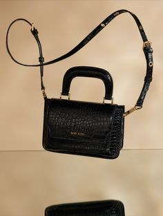 $199 : Versatile + cruelty free. Our best selling Noir Croco Reader Satchel is the perfect sized cross body bag. Use with the detachable, adjustable strap as a shoulder bag, belt it on your waist, carry by the handle, or add a Barricade Strap for signature Sans Beast style.  Trimmed with gold plated custom moulded zinc alloy dogclips + an adjustable pin buckle + metal eyelet strap for the ultimate in verstality. Satchel, Crossbody Bag, Vegan Handbags, Vintage Luggage, My Bags, Cruelty Free, Fashion Bags, Cross Body, Fendi