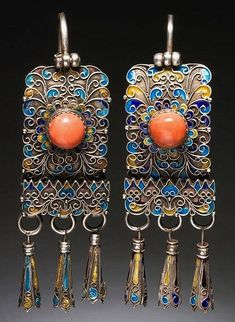 Mongolia, Chahar Province. Earrings; made of silver, coral, (possibly) turquoise and (certainly) enamel. Worn by married women as part of their headdress. These are not very old: 20th century (and probably even after 1950, I would think); but quite attractive. ©World Jewellery Museum, South Korea.