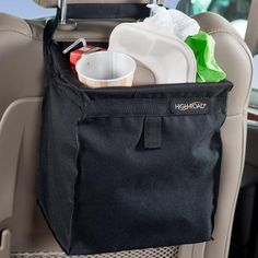 The first leakproof, hanging car trash bag that won't tip - even on the tightest turns. The High Road black TrashStash auto litter basket features a full liner and holds of car trash. Made of durable polyester. Trash Can For Car, Car Trash, Trash Bag, Best Car Seats, High Road, Garbage Can, Simple Bags, Back Seat, Car Accessories