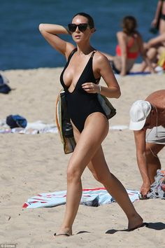 Her eye-catching swimsuit left little to the imagination thanks to it's wide-cut neckline...