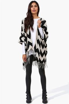 Wrap open cardigan that is extremely cozy! Has fringe hanging detailing on each side and color blocked print throughout. It would look darling with a crop top and jean shorts!