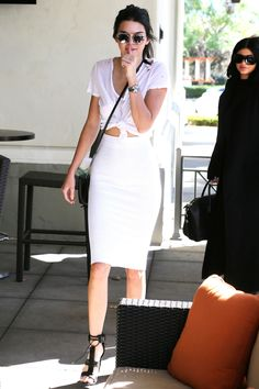 Who: Kendall Jenner What: Jenner opts for sleek simplicity in a fitted white pencil skirt worn with a tied white v-neck tee and Tom Ford sandals. Get the look now: J. Crew t-shirt, $30, jcrew.com. - HarpersBAZAAR.com