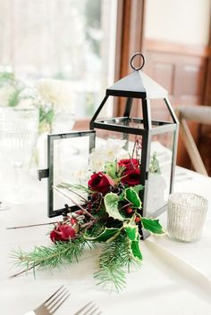 Wedding Flowers - Every festive table needs a centerpiece, and a wedding table is no exception. If you are planning a winter wedding, what centerpiece would you choose? Yes, classical floral centerpieces are a great idea – white or red. Christmas Wedding Centerpieces, Lantern Centerpiece Wedding, Winter Centerpieces, Christmas Lanterns, Wedding Lanterns, Centerpiece Decorations, Wedding Decorations, Rustic Christmas, Christmas Decorations
