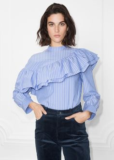 Crisp cotton shapes this striped frill shirt, made for an effortless yet modern look. Snap button closure, centre back Keyhole detail, cente back Length of shirt: 61 cm (size Model wears: EU UK US 6 Classy Work Outfits, Simple Outfits, Modest Fashion, Fashion Dresses, Frill Shirt, Indian Designer Outfits, Batik Dress, Beautiful Blouses, Facon