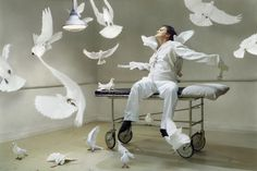 Martin Schoeller | Quentin Tarantino with Doves (2004) | Available for Sale | Artsy
