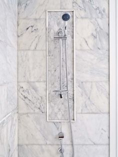 I like the mix of tile sizes but using the same material. Classic bathroom