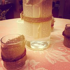 If you decided to incorporate the music theme you could do short candles wrapped in sheet music/chord and burlap/lace.