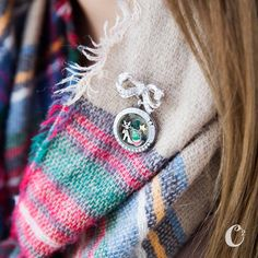 Pick your favorite scarf and fill your Locket with matching Charms. Attach Locket to your Bow-Quet Locket Clasp and pin to your scarf!