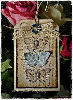Wine bottle tag. Like the use of pearls for the body of butterfly.