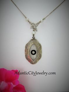 Stunning antique Evil Eye Filigree pendant. 14 kt white gold with .10 ct diamond and natural pearls. Don't miss out on this beautiful piece, only $500.00!
