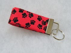 Mini Key Fob   Black paw prints on red by doodlebugquilts on Etsy (Accessories, Keychain, Wristlet, key fob, handmade, sewn, fabric, mini key fob, red, black, paw print, dog, cat)