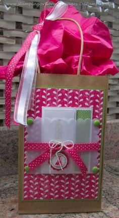 Gift Bag - what to do with the card besides tucking it inside. Also great to display a handmade card as part of the decoration.