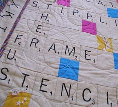 Found this while looking for ideas on doing circles in the quilting part. But absolutely adore the entire Scrabble theme on this quilt as well.