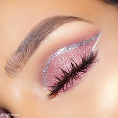 pink glitter eyeshadow outlined with a silver glitter eyeliner topped off with some falsies