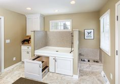 Racine Mudroom addition - Custom dog bathing station with stainless undermount water bowl featuring easy draining. Pull-out drawer with steps for easy access to the tub. The homeowners no longer have back pain with the standing station.