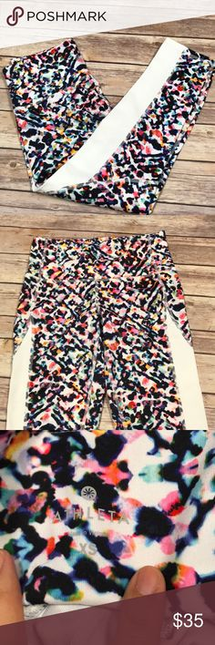 Athleta Crop Leggings (XS) Athleta Cropped Leggings. Size XS. Excellent condition. Only worn once. Abstract floral pattern with white color blocking on the side panels to give a flattering fit. Squat proof! Athleta Pants Leggings